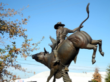 Bull rider guards the entrance to the Clovis Rodeo Grounds