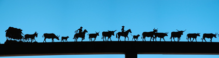 Silhouettes of ranching activities at an exhibit near Baker